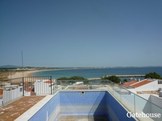 Lagos €196,000Bank RepossessionSea view apartment with 2 beds, 2 baths & roof terrace pool…
